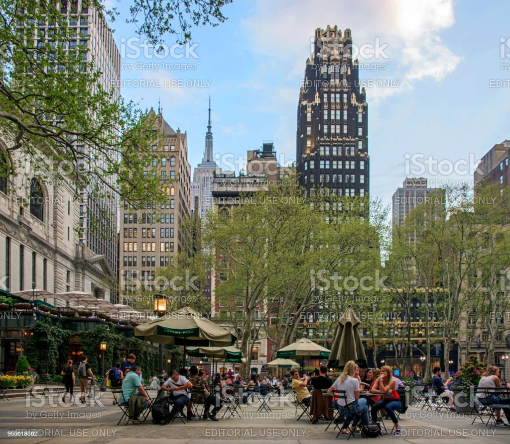 Bryant Park Terrace with People Seating and Enjoying a Warm Spring Evening stock photo