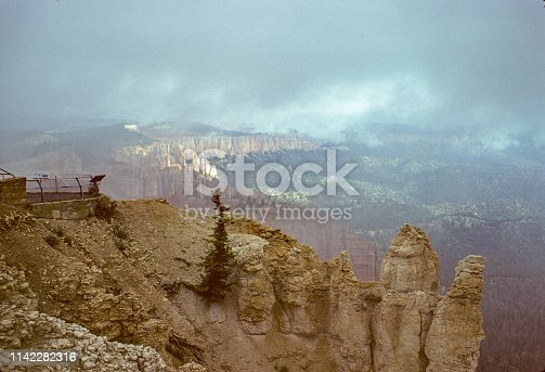 Bryce Canyon National Park - Clouds obscure the hoodoos and rock formation. July 1975 - Scanned from Kodachrome slide.