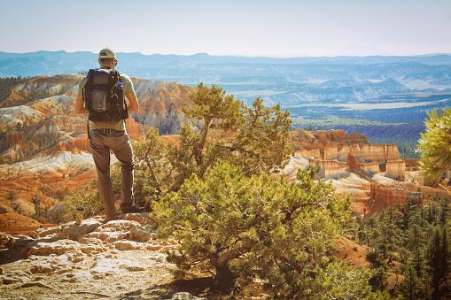Bryce Canyon National Park, Utah. Young man admires beautiful view.  Bryce Canyon, Utah/USA - October 12, 2020