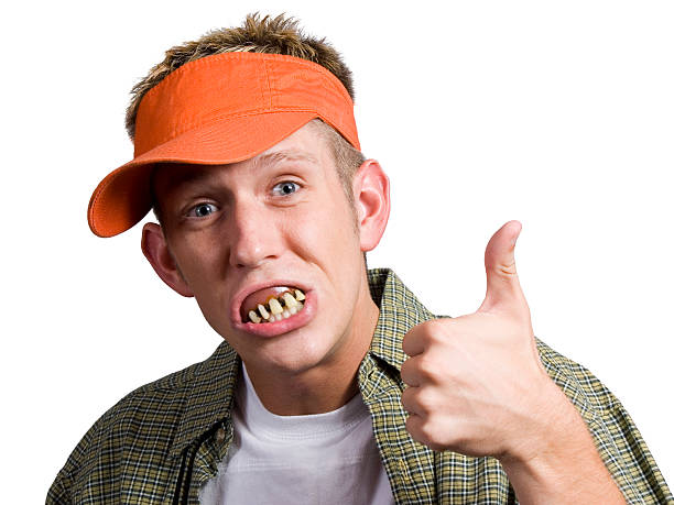bubba's approval - teeth stock photos and pictures