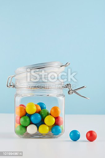 Close up shot of colored bubble gums in a jar.