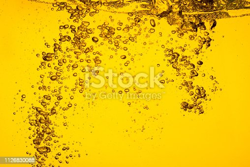 Bubble in liquid yellow color car oil or beer  juice syrup for background