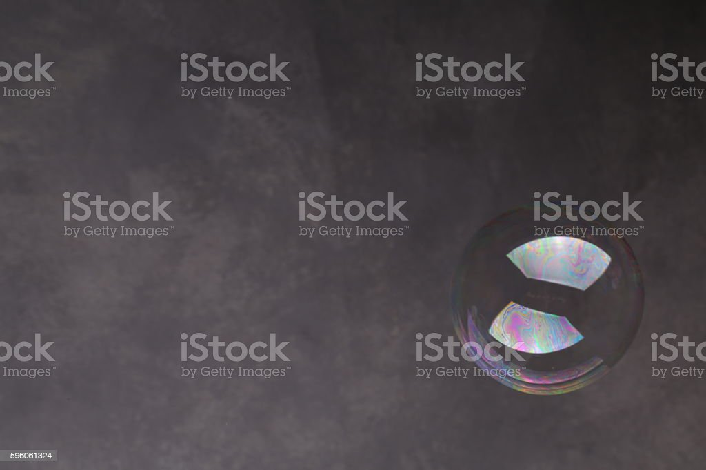 Bubble in the air. Close up. Gray background royalty-free stock photo