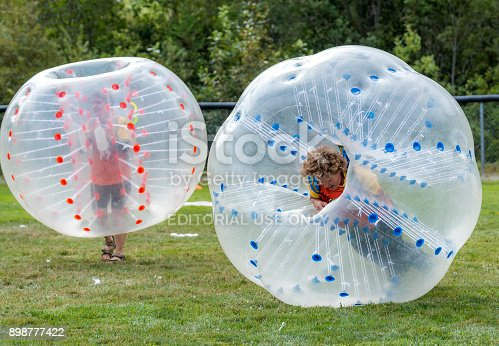 Saint John, New Brunswick, Canada - August 26, 2017: Events at the Dragon Boat Festival. People play bubble soccer.