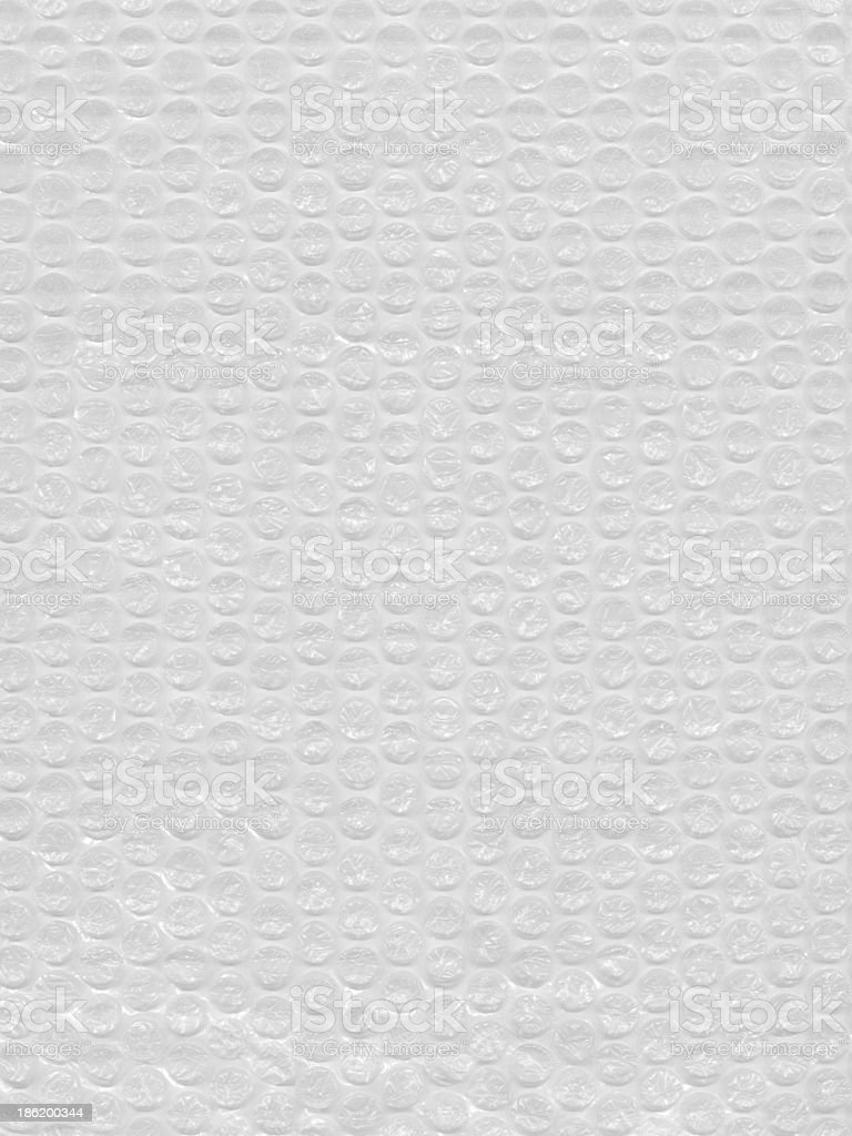 Bubble wrap. Air bubbles padding material background texture stock photo