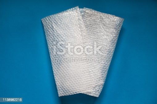 istock Bubble wrap on blue background. 1138982215