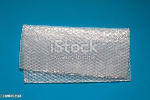 istock Bubble wrap on blue background. 1138982240