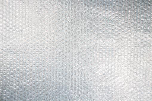 Plastic bubble wrap texture background, uneven lightning