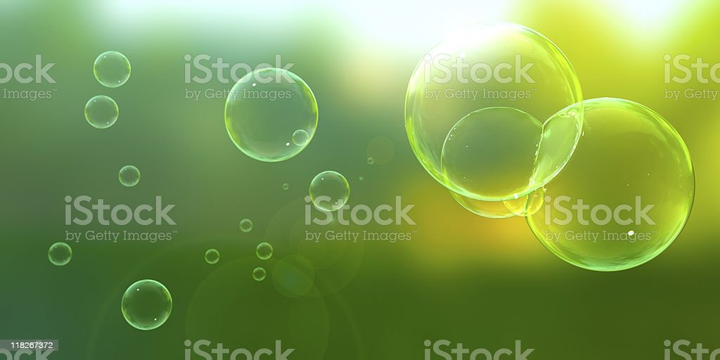 Bubbles blown outdoors on a sunny day Soap bubbles floating about on a sunny afternoon. Abstract Stock Photo