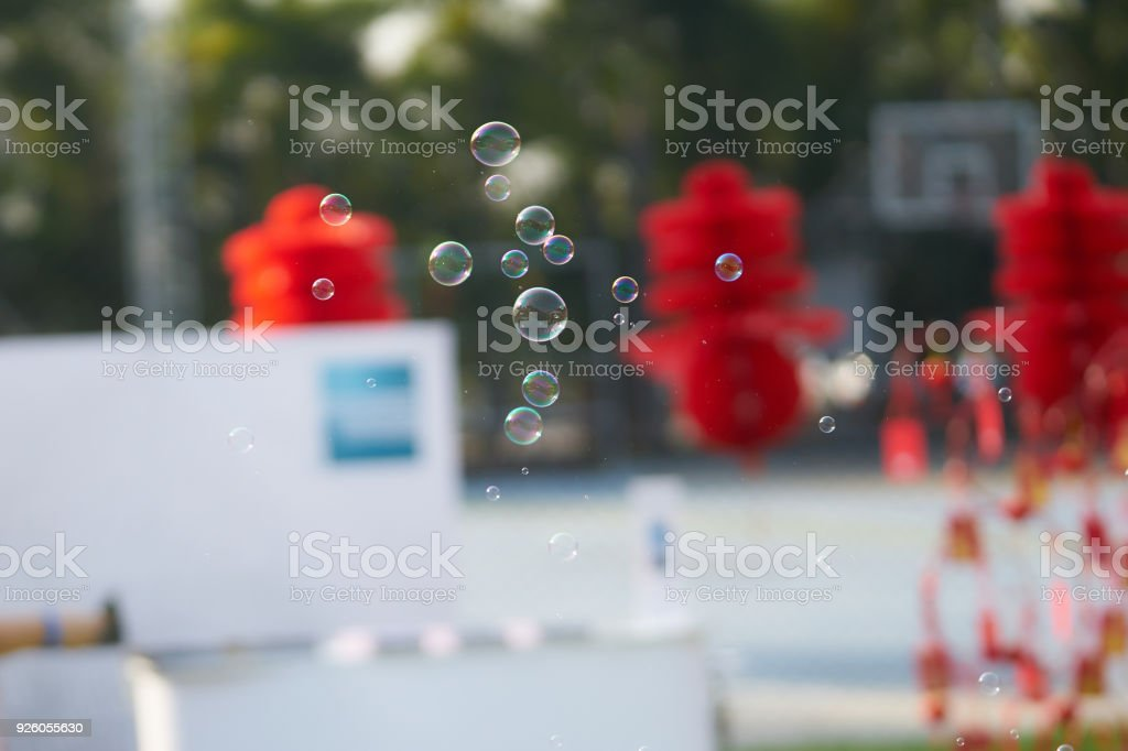 bubbles float or fly in the air with blur background,outdoors ,day time stock photo