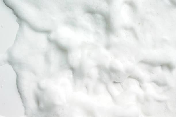 bubbles foam white washing shower - gommapiuma foto e immagini stock