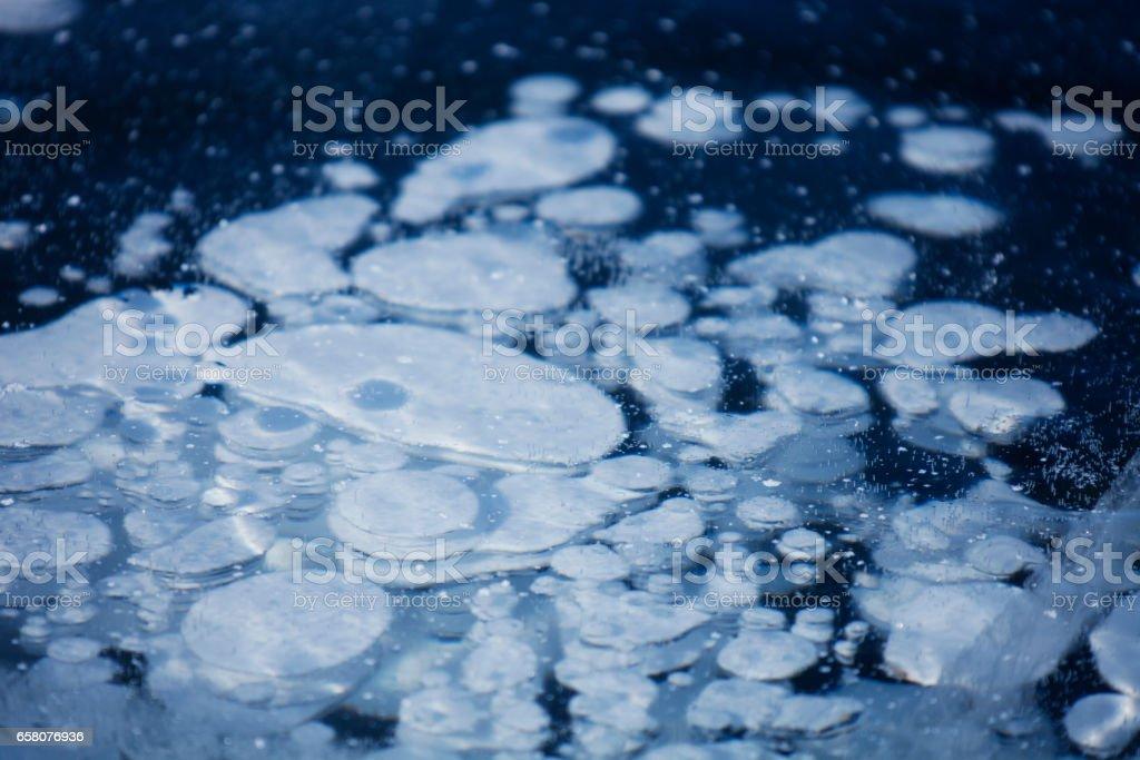 bubbles in ice of Baikal lake royalty-free stock photo