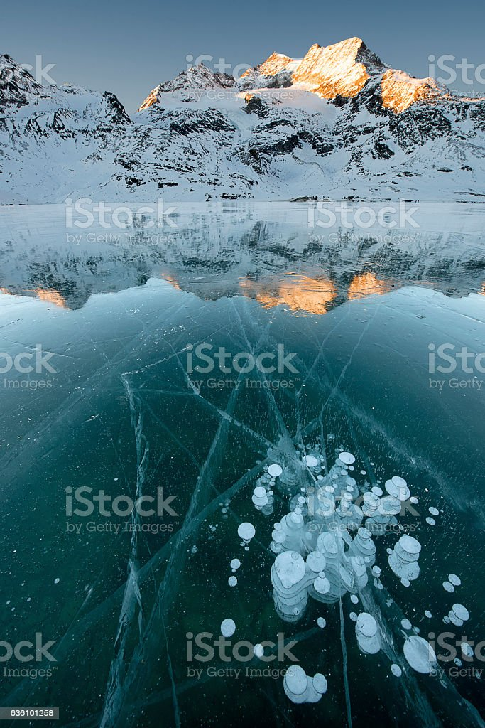 Bubbles in the Ice - Lago Bianco at Bernina Pass stock photo