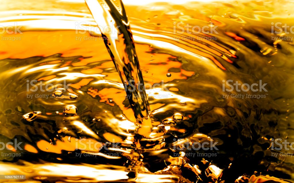 Bubbles in Water Oil beer gold Beautiful abstract background stock photo
