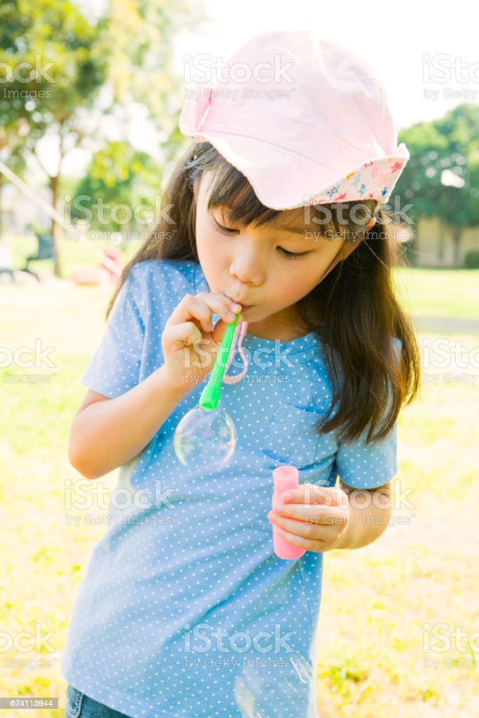 Bubbles make the ball girl royalty-free stock photo