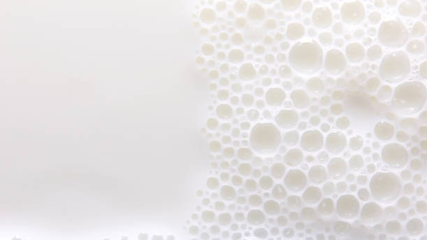 Bubbles on milk surface stock photo