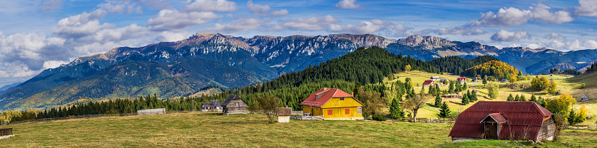 Fundata vilage with Bucegi mountains in the background, Brasov, Romania