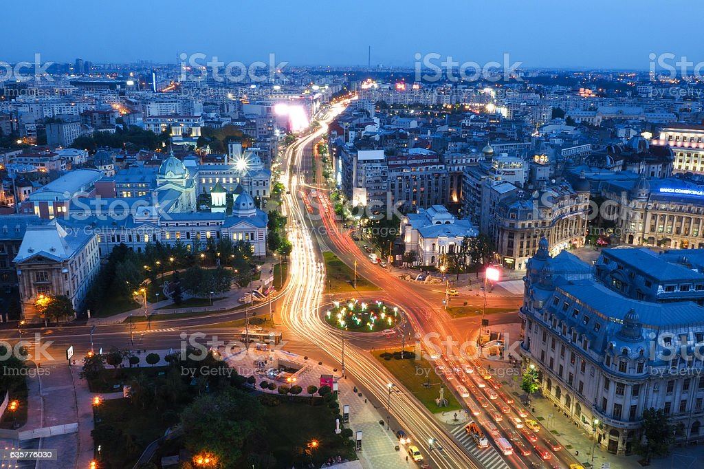 Bucharest city at night. University Square, KM 0 of the stock photo