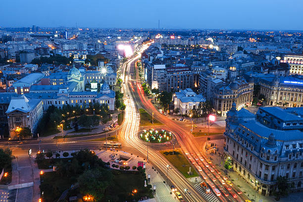 Bucharest city at night. University Square, KM 0 of the stock photo