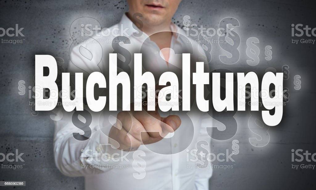Buchhaltung (in german Accounting) touchscreen is operated by man stock photo