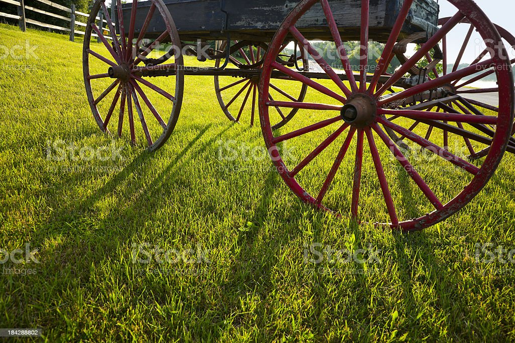Buckboard Carriage Wheels at Sunrise royalty-free stock photo