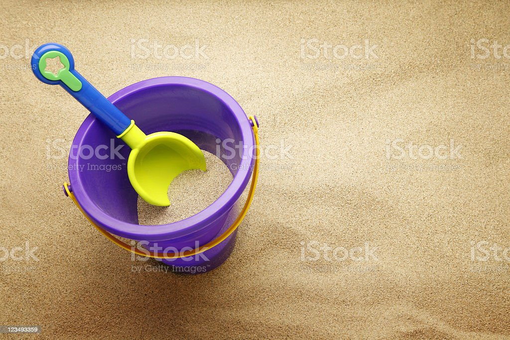bucket and shovel in the sand stock photo