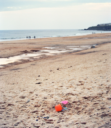 Bucket And Spade Left At The Beach Stock Photo - Download Image Now