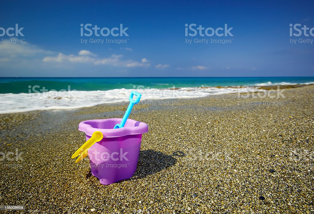 Bucket and spade on the beach sand royalty-free stock photo