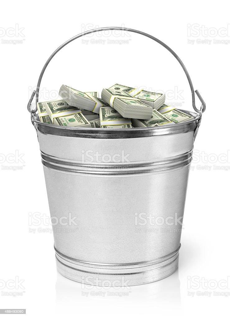 Bucket full of money stock photo