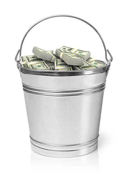 Bucket full of money stock photo