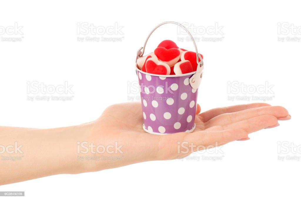 Bucket jelly hearts in hand stock photo