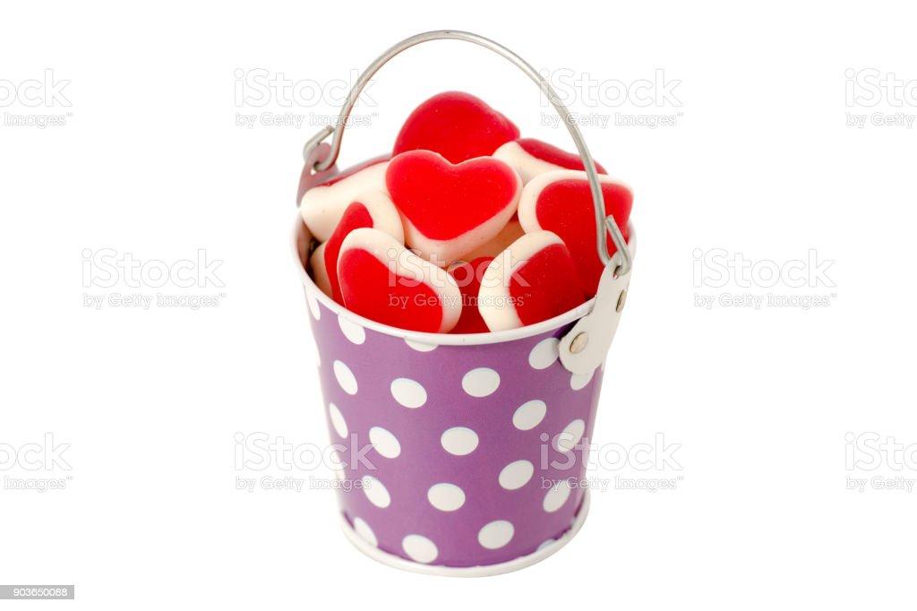 Bucket jelly hearts isolated stock photo