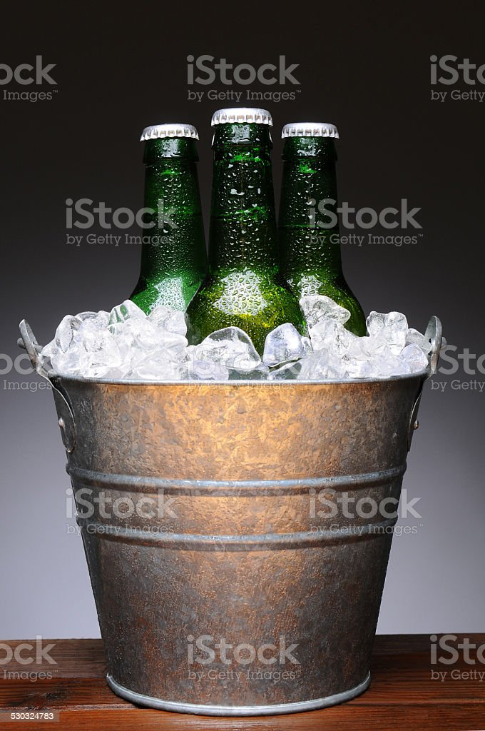 Bucket of Beer on Wood stock photo