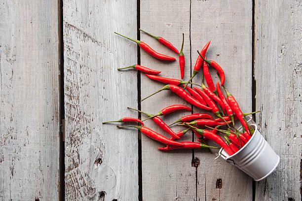 Bucket of Chilies stock photo