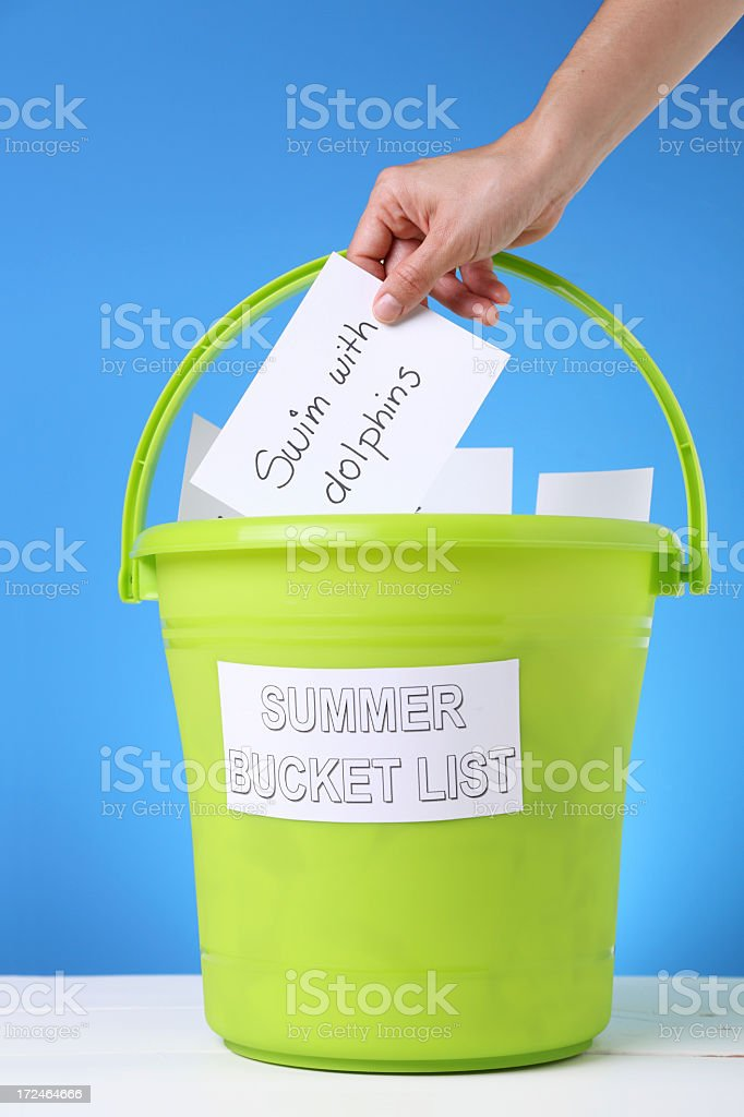 A bucket of different things to do in the summer stock photo