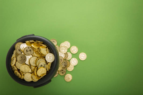 bucket of Gold on Green Background for St. Patrick's Day stock photo