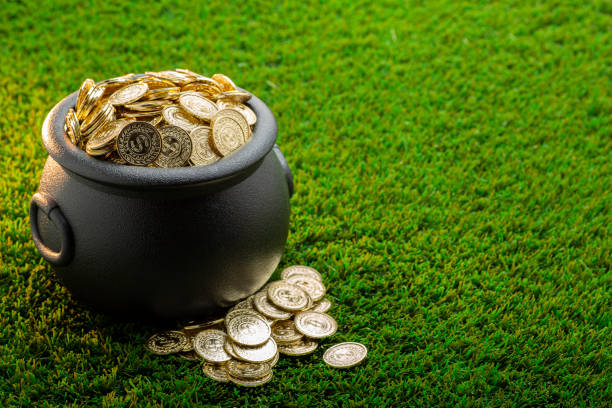 Bucket of Gold on Green Grass stock photo