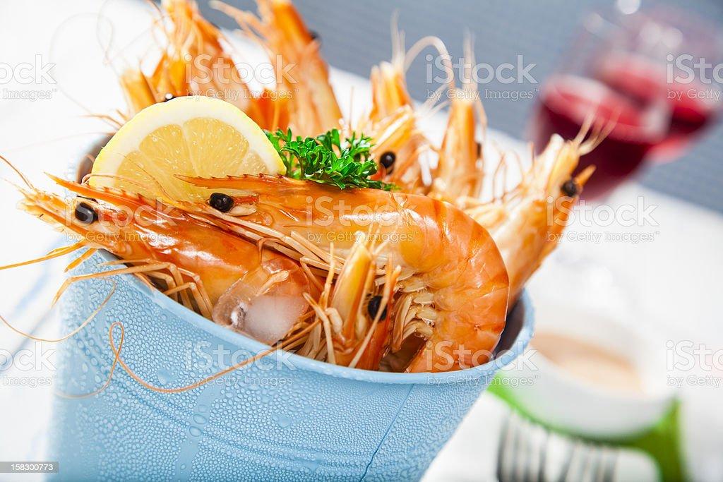 Bucket of king prawns on ice stock photo