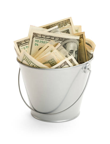 Bucket of Money Bucket Filled with Lots of Money Isolated on White Background. bucket stock pictures, royalty-free photos & images