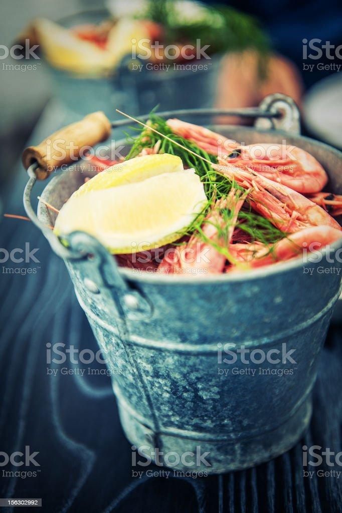 Bucket of pink shrimps stock photo