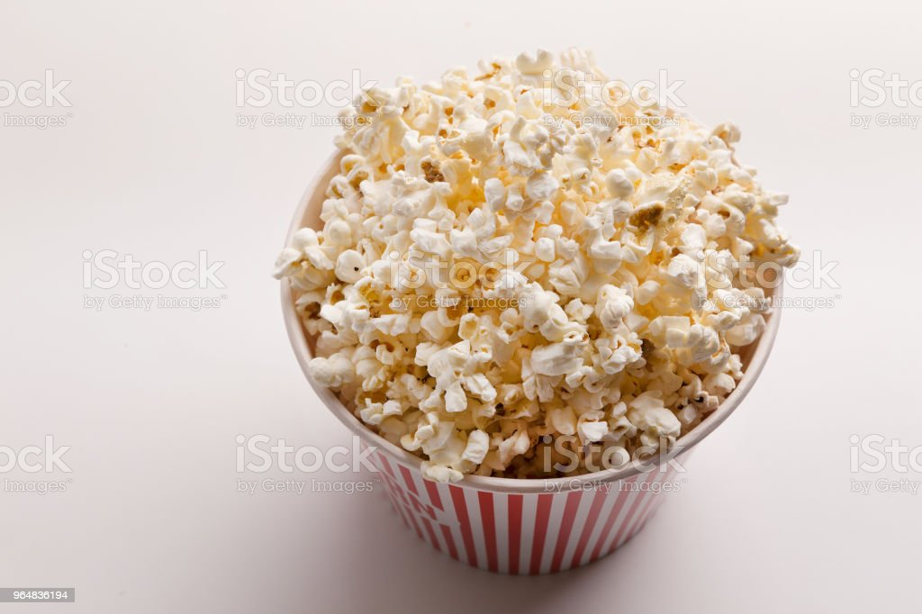 Bucket of popcorn on white background royalty-free stock photo