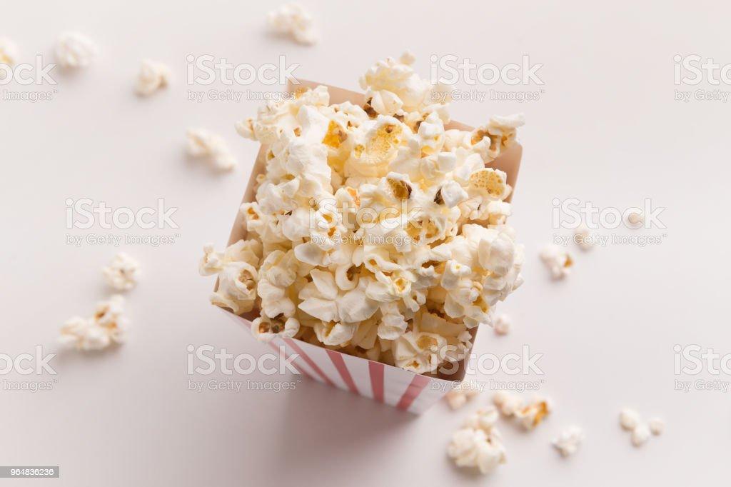 Bucket of popcorn on white background royalty-free stock photo