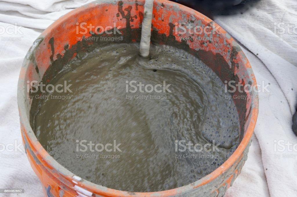 A Bucket of Wet Concrete stock photo