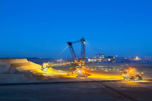 Bucket Wheel Excavator At Night A giant Bucket Wheel Excavator at work in a lignite pit mine at night tagebau stock pictures, royalty-free photos & images