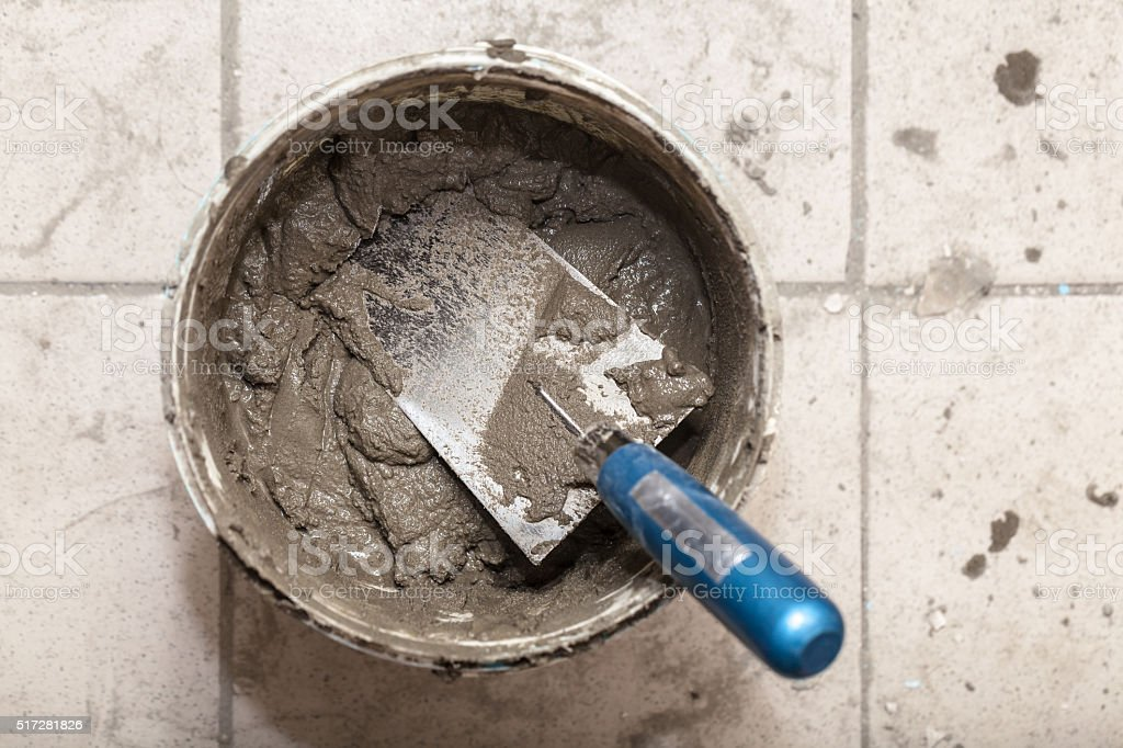 bucket with cement and trowel stock photo