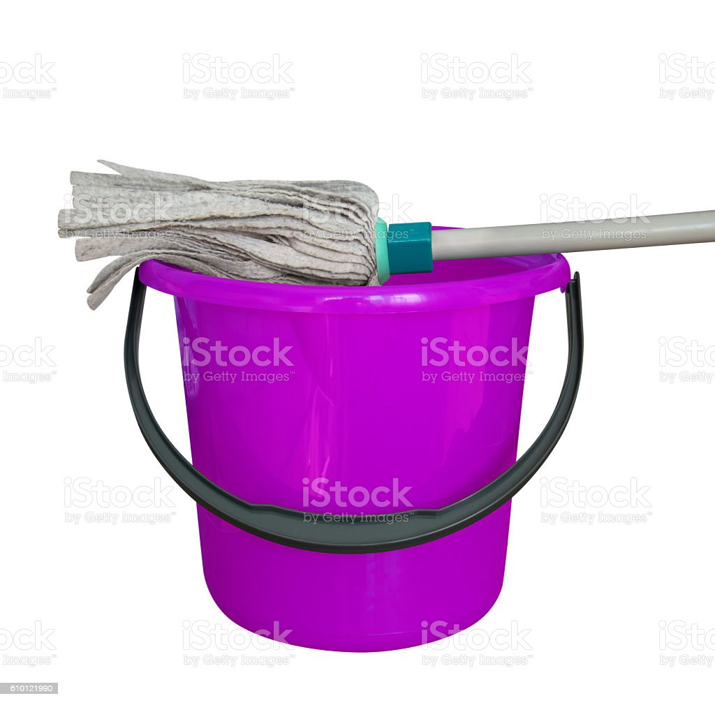 Bucket with cleaning mop - violet stock photo