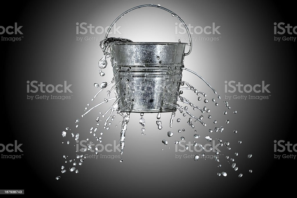 bucket with holes royalty-free stock photo