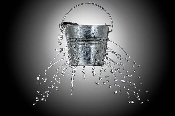 bucket with holes stock photo