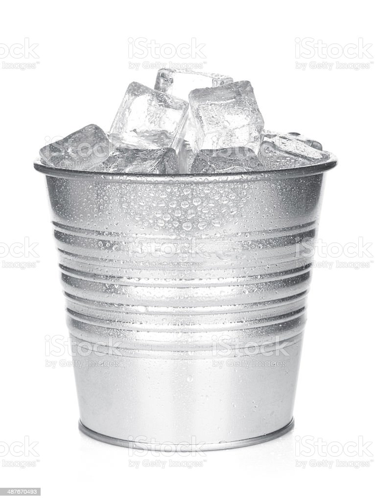 Bucket with ice cubes stock photo