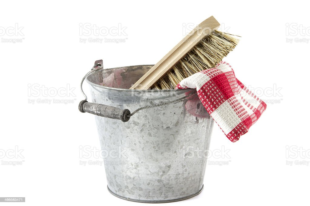 bucket with scrubbing brush and tea towel stock photo